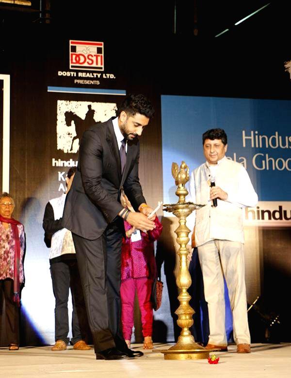 Actor Abhishek Bachhan with Manek Davar during the inauguration of Kala Ghoda festival in Mumbai on Feb. 7, 2015. - Abhishek Bachhan