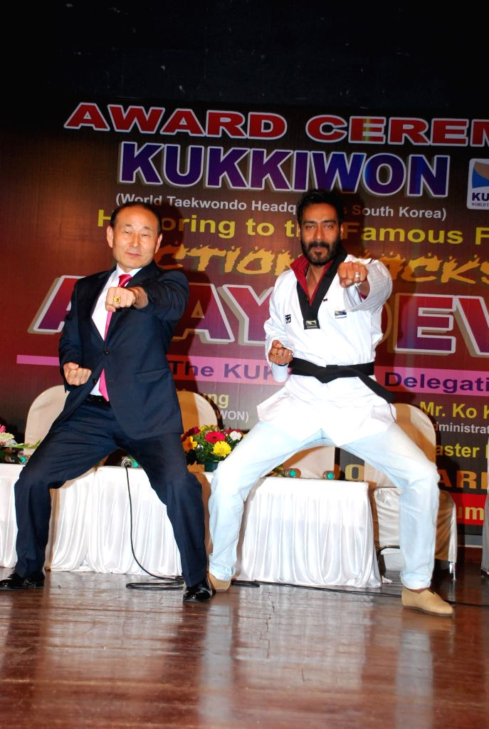 Actor Ajay Devgan being felicitated by Grandmaster Hwang  by Taekwondo Masters from Korea (Kukkiwon) in Mumbai on Nov. 22, 2014.
