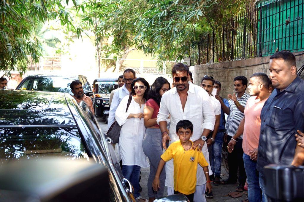 Mumbai: Actor Ajay Devgn along with his wife Kajol, son Yug Devgn and daughter Nyse Devgn at a cinema theater in Mumbai on Oct 26, 2017.(Photo: IANS) - Ajay Devgn and Kajol