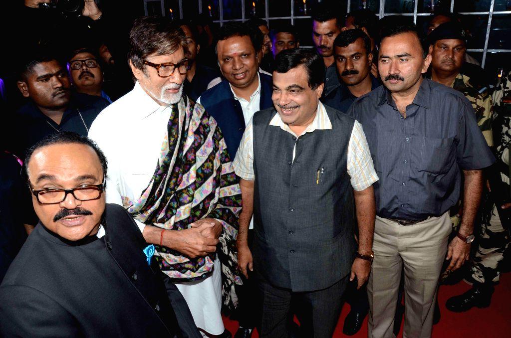 Actor Amitabh Bachchan and Union Road Transport Minister Nitin Gadkari during the wedding reception of Bollywood filmmaker Smita Thackeray`s son Rahul Thackeray and Dr. Aditi Thackeray in ... - Amitabh Bachchan
