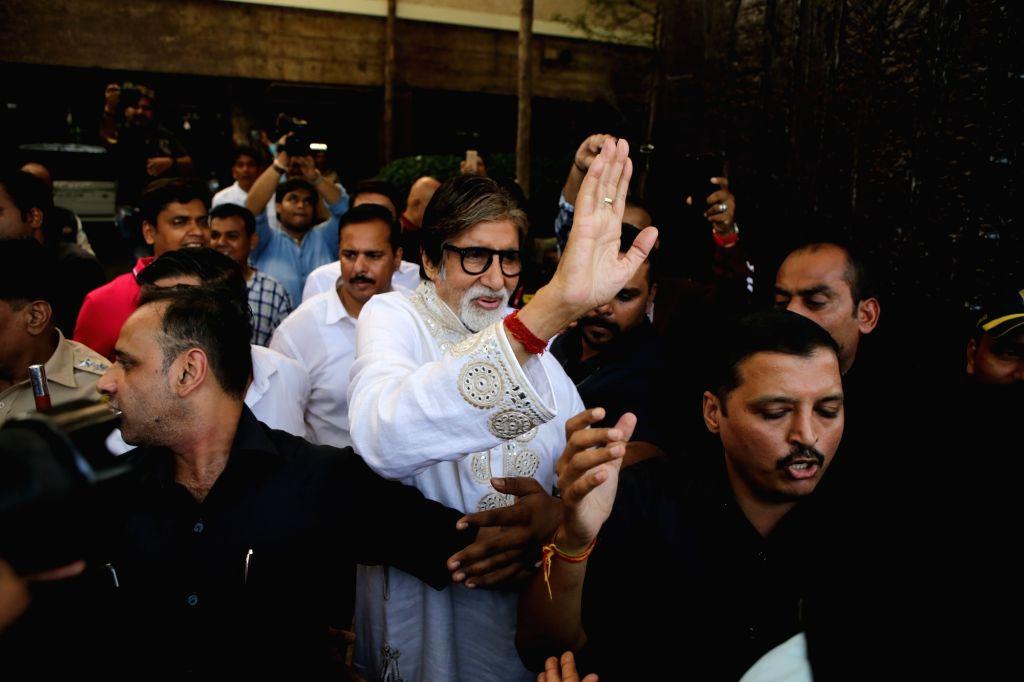 "Mumbai: Actor Amitabh Bachchan greets fans who gathered outside his residence ""Prateeksha"" to wish him on his 77th birthday, in Mumbai on Oct 11, 2019. (Photo: IANS) - Amitabh Bachchan"
