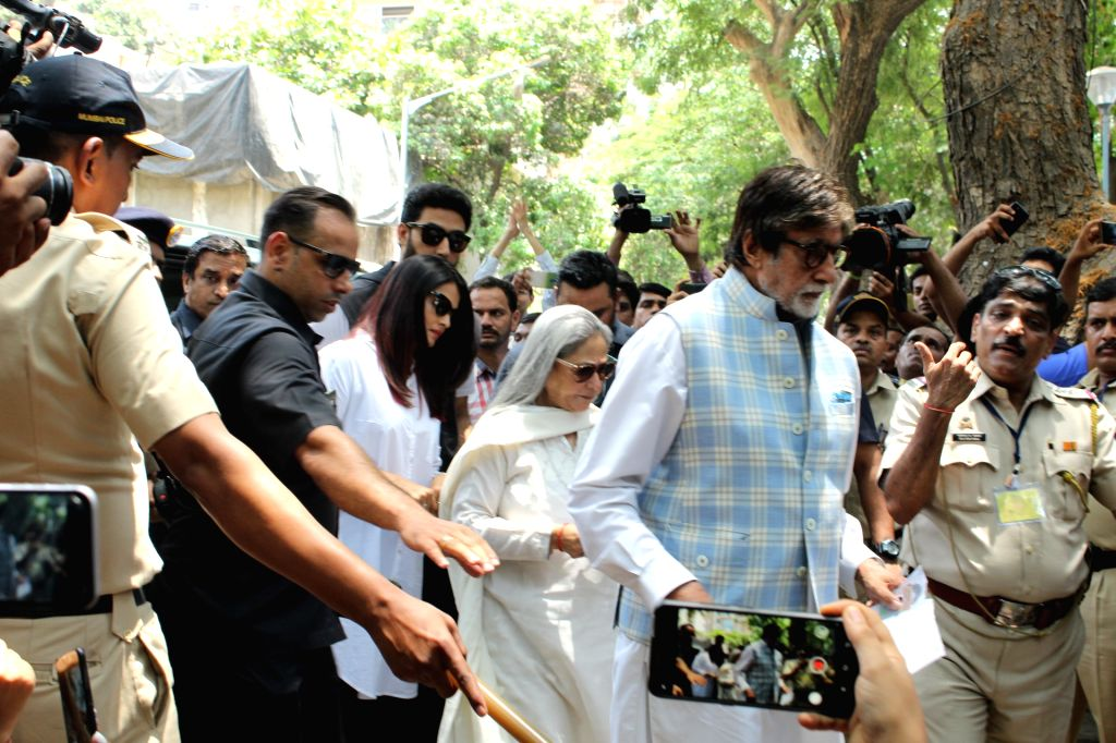 Mumbai: Actor Amitabh Bachchan, his son Abhishek Bachchan, wife Jaya Bachchan and his daughter-in-law Aishwarya Rai Bachchan arrive to cast their votes for the for the fourth phase of 2019 Lok Sabha elections, in Mumbai on April 29, 2019. (Photo: IAN - Amitabh Bachchan, Aishwarya Rai Bachchan, Abhishek Bachchan and Jaya Bachchan