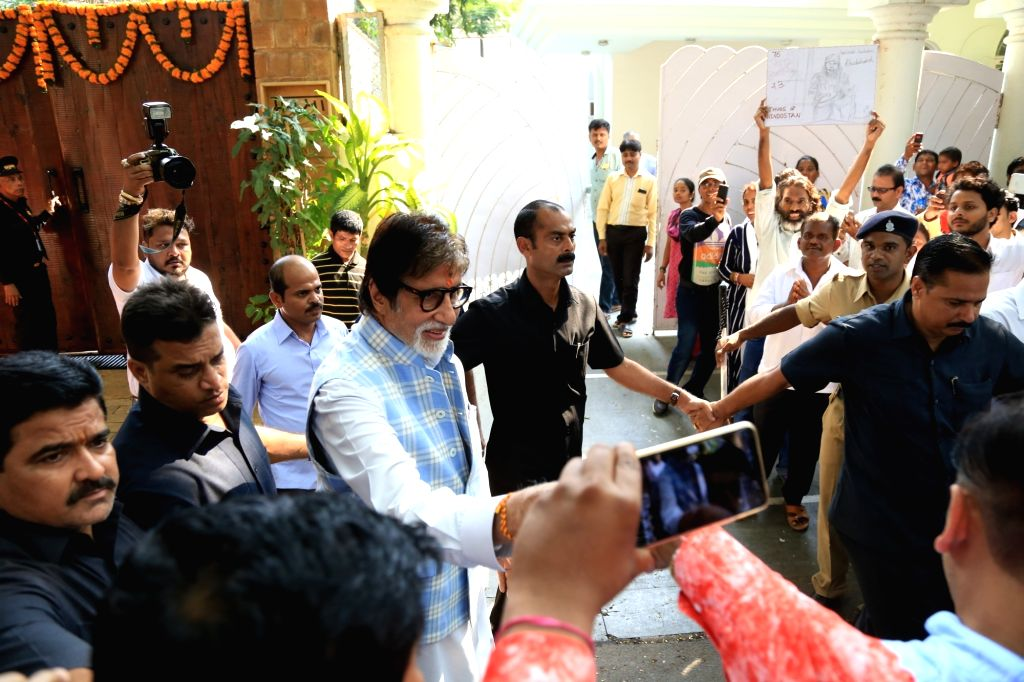 Mumbai: Actor Amitabh Bachchan meet fans who stood outside the actor's residence on his birthday in Mumbai on Oct 11, 2018. (Photo: IANS) - Amitabh Bachchan