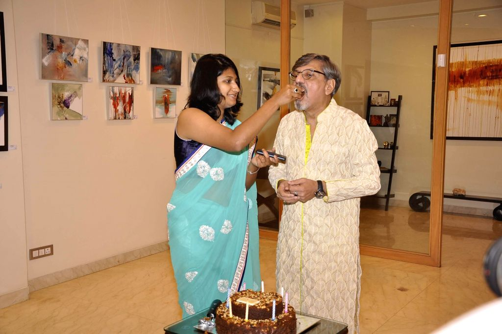 Actor Amol Palekar along with his daughter Samiha during his painting exhibition, in Mumbai on Nov 25, 2014.