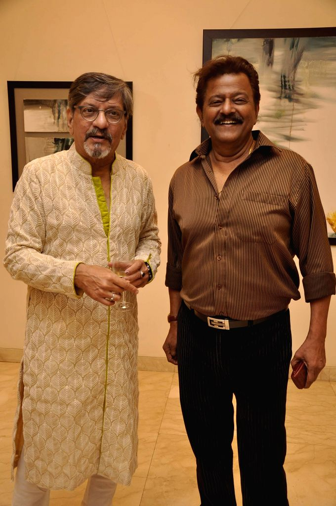 Actor Amol Palekar with Marathi film actor Ramesh Bhatkar during his painting exhibition, in Mumbai on Nov 25, 2014.