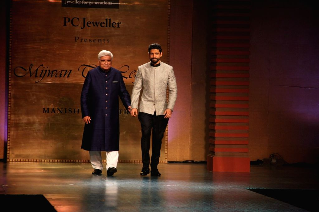 Actor and filmmaker Farhan Akhtar and lyricist Javed Akhtar during Manish Malhotra's fashion show in Mumbai, on April 4, 2015, held to support actor Shabana Azmi`s cause of the Mijwan village ... - Farhan Akhtar and Manish Malhotra