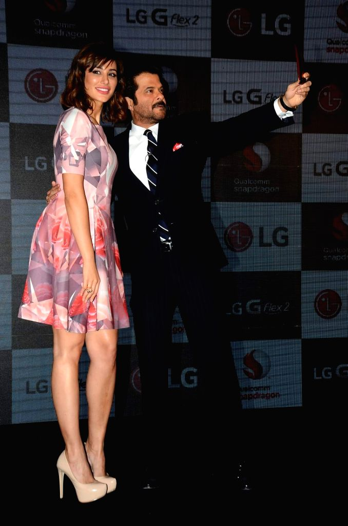 Actor Anil Kapoor and actress Nargis Fakhri during the launch of LG G Flex2 phones, in Mumbai, on April 30, 2015. - Anil Kapoor