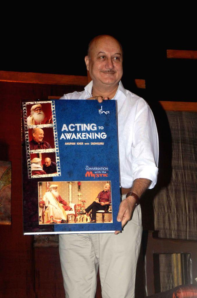 Actor Anupam Kher releases the DVD 'Acting to Awakening' in Mumbai, on Jan 16, 2015.