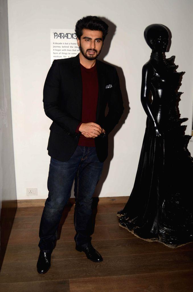 Actor Arjun Kapoor during the opening of fashion designer Gaurav Gupta's store in Mumbai on Nov 27, 2014. - Arjun Kapoor