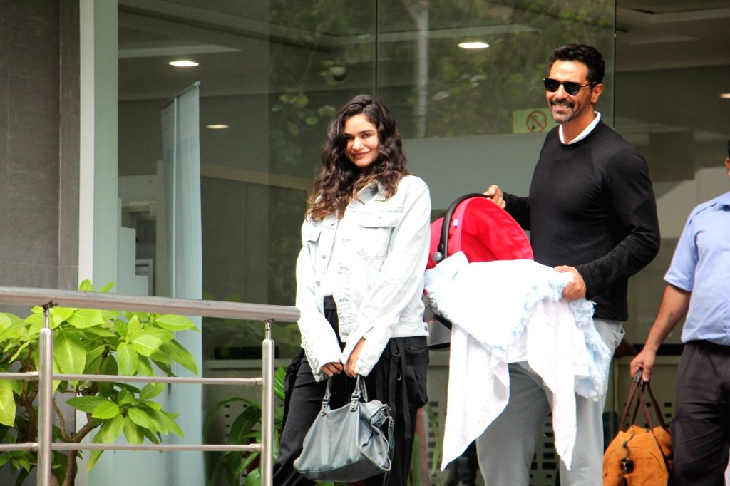 Mumbai: Actor Arjun Rampal with Gabriella Demetriades and newborn baby at Hinduja Hospital in Mumbai, on July 21, 2019. (Photo: IANS) - Arjun Rampal