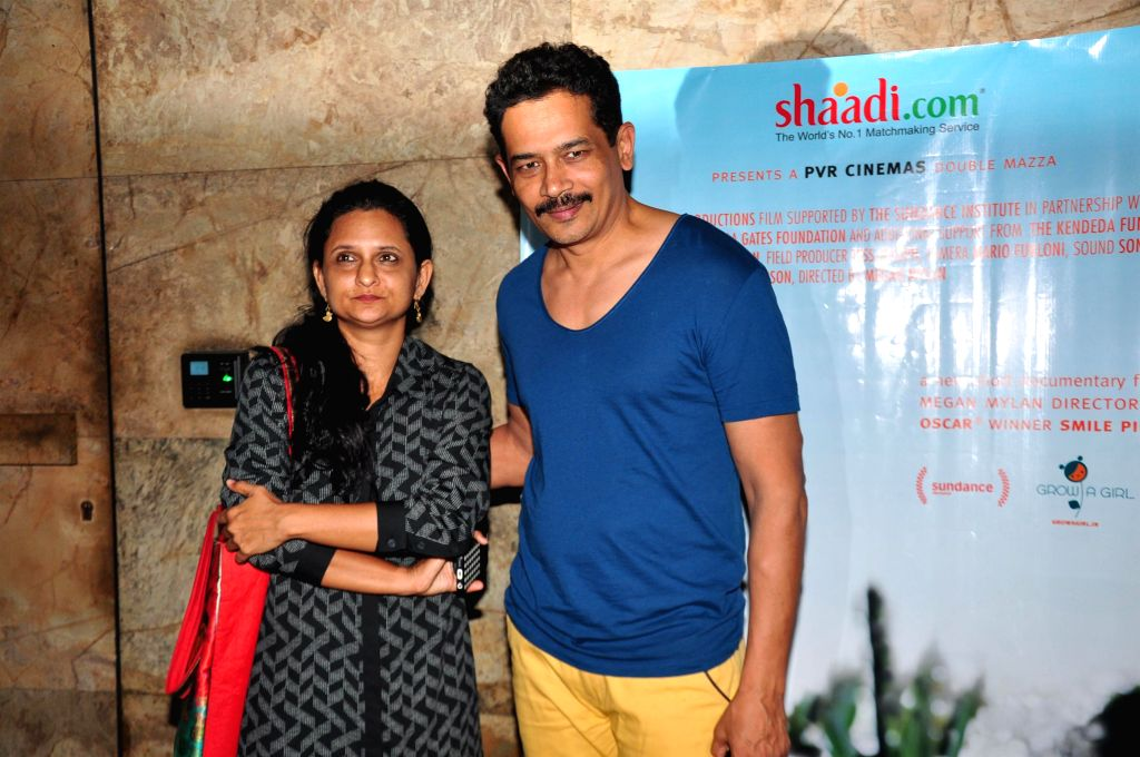 Actor Atul Kulkarni along with his wife Geetanjali Kulkarni during the special screening of documentary film After My Garden Grows in Mumbai, on Nov. 14, 2014. - Atul Kulkarni and Geetanjali Kulkarni