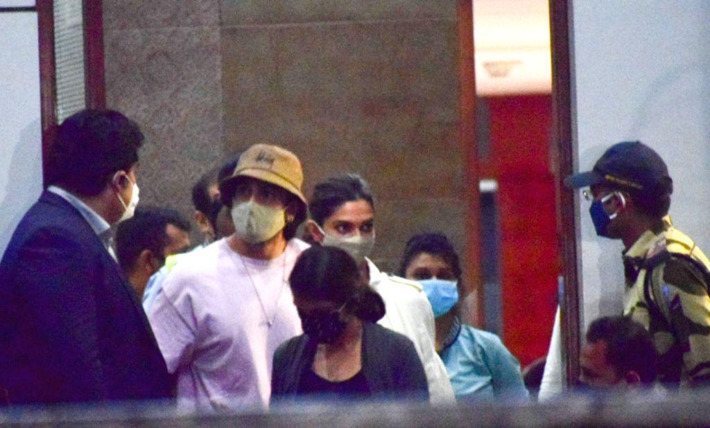 Mumbai: Actor couple Ranveer Singh and Deepika Padukone seen at the Chhatrapati Shivaji Maharaj International Airport after they returned to Mumbai from Goa, on Sep 24, 2020. The Narcotics Control Bureau (NCB) has summoned actress Deepika Padukone in - Deepika Padukone, Ranveer Singh and Sushant Singh Rajput