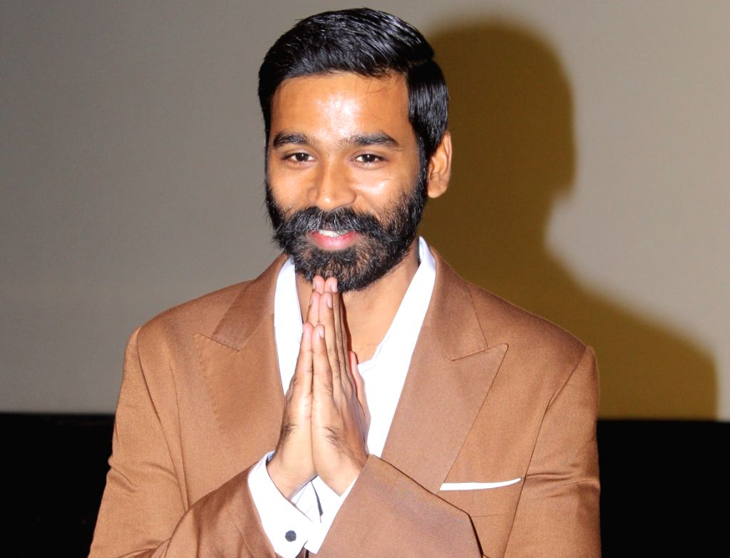 "Mumbai: Actor Dhanush at the trailer launch of his upcoming film ""The Extraordinary Journey of the Fakir"", in Mumbai, on June 4, 2019. (Photo: IANS) - Dhanush"