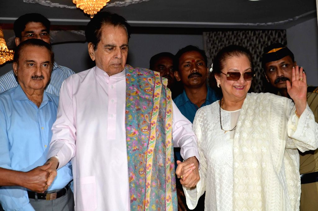 Actor Dilip Kumar along with his wife Saira Banu after being discharged from a hospital in Mumbai on Thursday, Dec 11, 2014.