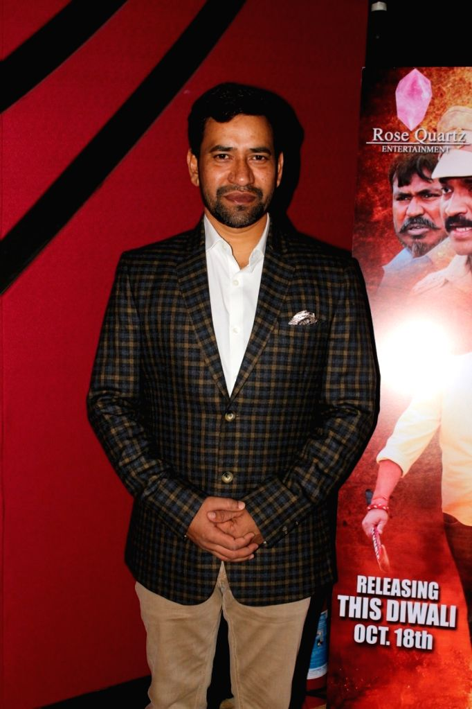 "Mumbai:Actor Dinesh Lal Yadav during the trailer launch of film ""Kaashi Amarnat"" in Mumbai on Sept 16, 2017. - Dinesh Lal Yadav"