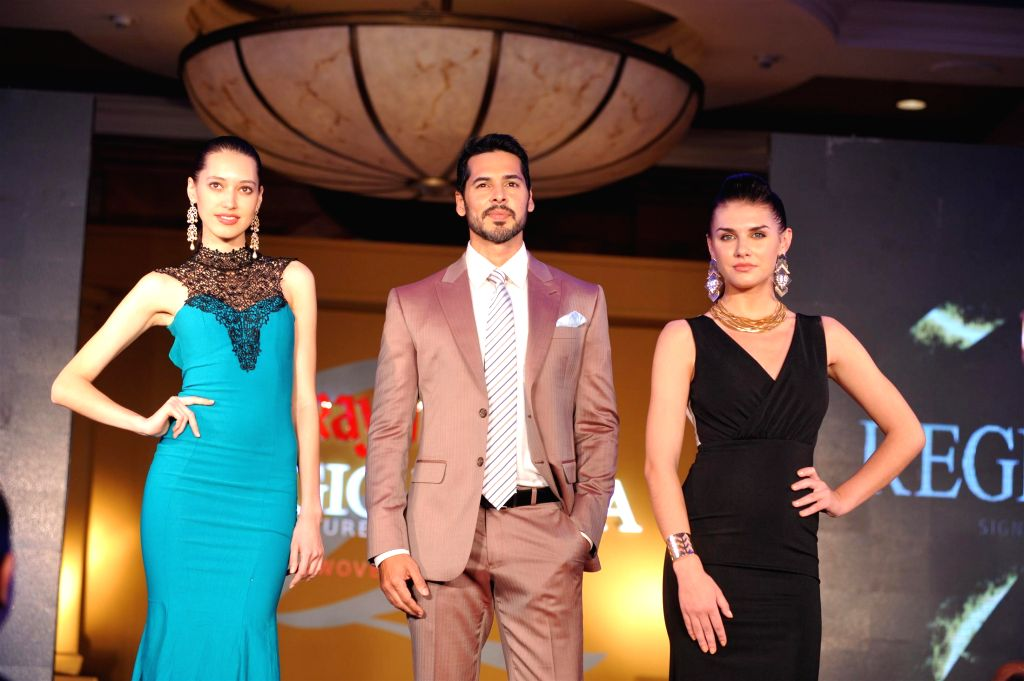 Actor Dino Morea showstopper at launch of Raymond`s new Signature luxury fabric from Italy in Mumbai on Nov. 11, 2014.