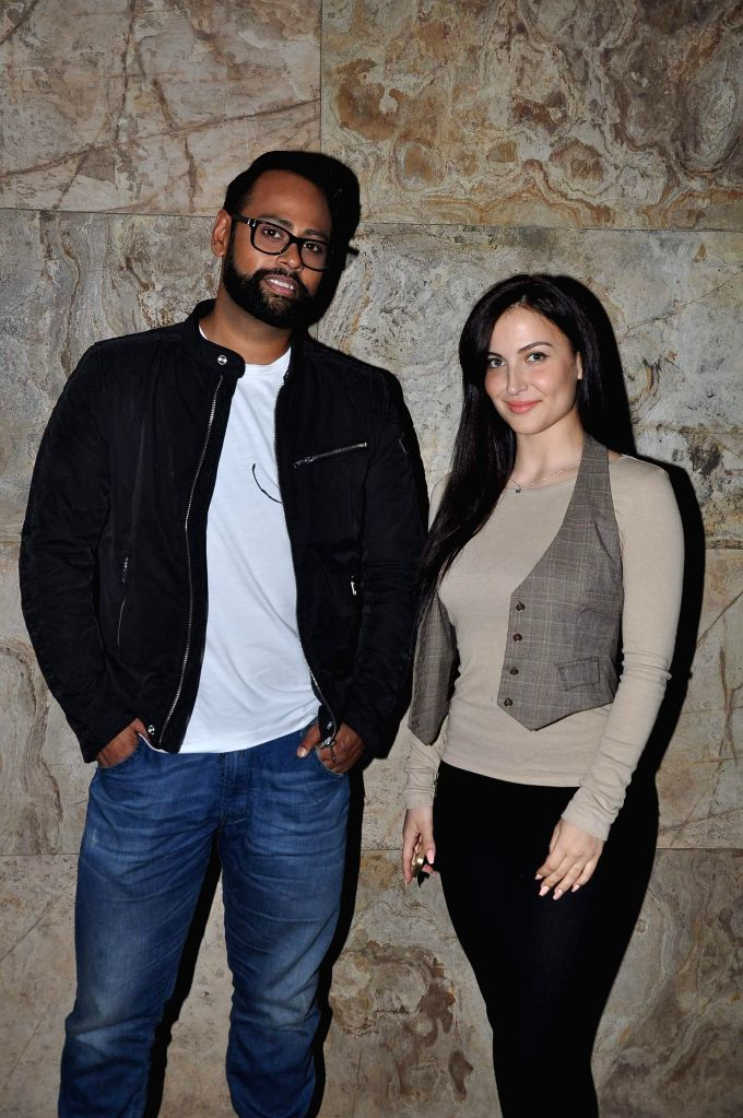 Actor Elli Avram and VJ Andy during the screening of film Big Eyes at Lightbox in Mumbai on Dec 30, 2014. - Elli Avram