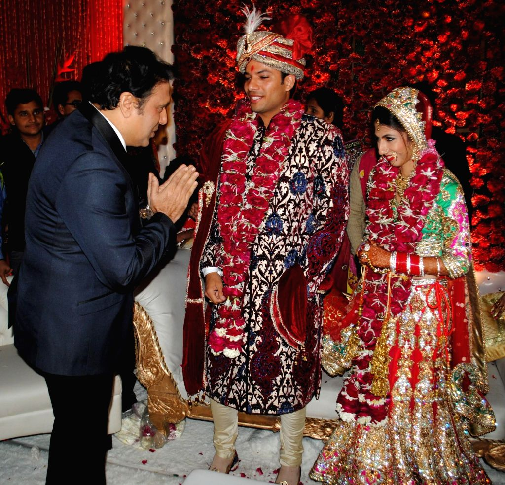 Actor Govinda, Atin and Lalita snapped at producer Krishna Choudhary's daughter's wedding in Mumbai on 12th February 2013 . - Govinda