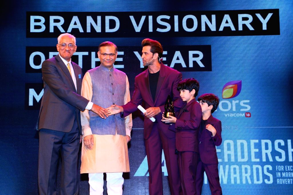 Actor Hrithik Roshan receives the Visionary of the Year (male) award at the International Advertising Association Awards ceremony hosted by Colours, in Mumbai on April 19, 2015. Also seen his ...