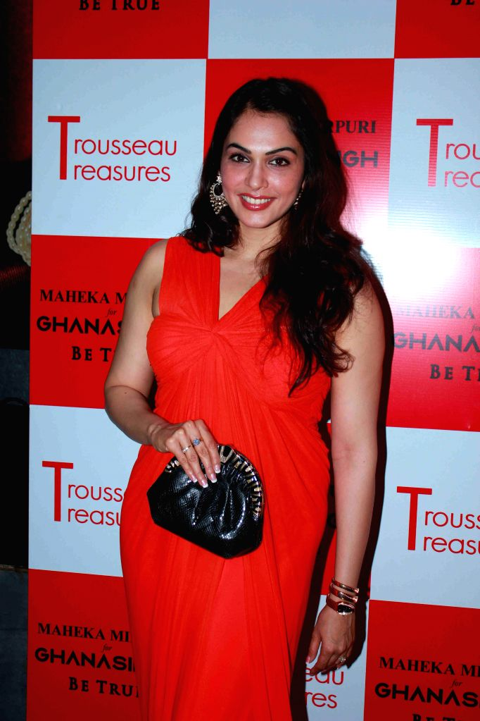 Actor Isha Koppikar during the unveiling of latest Trousseau Treasures collection by Maheka Mirpuri at Ghanasingh Be True Store in Mumbai, on Feb 11, 2015. - Isha Koppikar