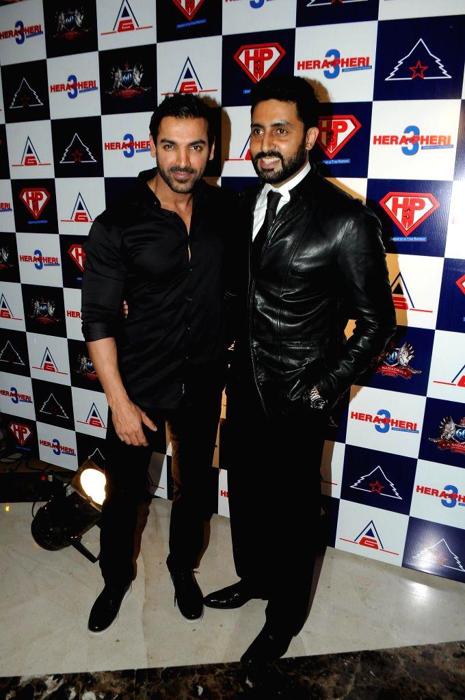 Actor John Abraham and Abhishek Bachchan during unveiling of the starcast of film Hera Pheri 3, in Mumbai, on Jan. 12, 2015. - John Abraham and Abhishek Bachchan