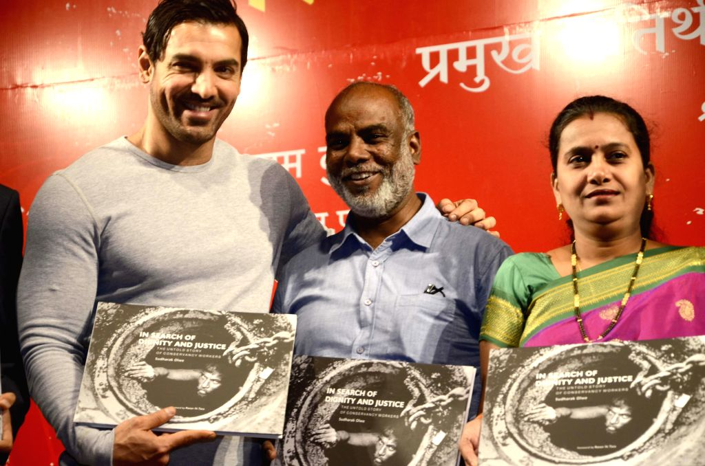 Actor John Abraham and Mumbai Mayor Snehal Ambekar at the launch of photojournalist Sudharak Olwe's book `In Search Of Dignity And  Justice` in Mumbai, on Jan 22, 2015. - John Abraham