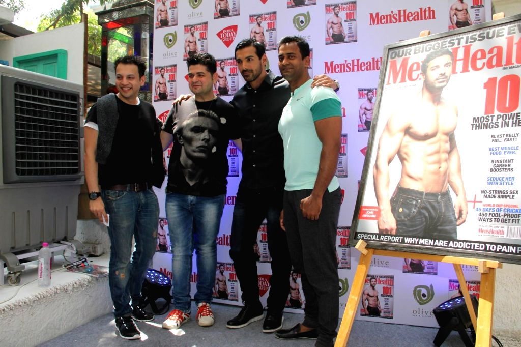 Actor John Abraham during the unveiling of Men's Health magazine's latest cover in Mumbai, on March 10, 2015.
