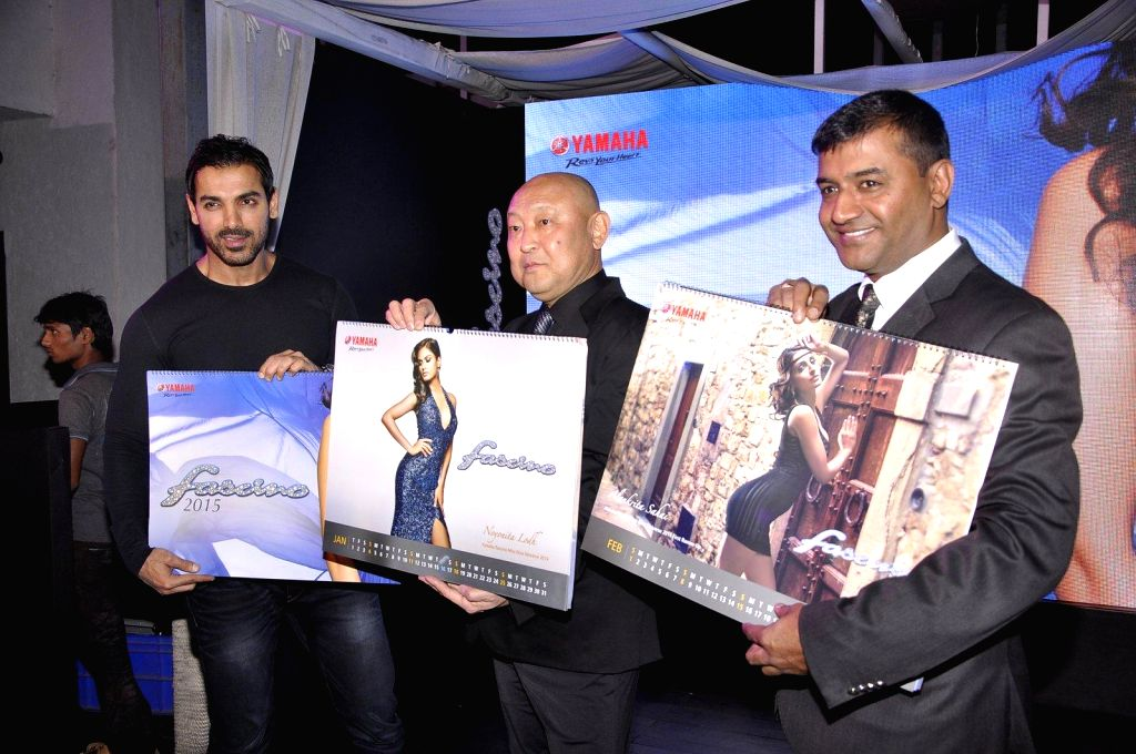 Actor John Abraham, Masaki Asano, MD, Yamaha Motors India and Roy Kurian, VP, Yamaha Motors India during the launch of Yamaha Fascino 2015 calendar in Mumbai on 13th Jan 2015 - John Abraham