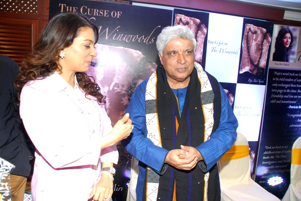 Actor Juhi Chawla and Javed Akhtar at the launch of Puja Miri Yajnik's book `The Curse of The Winwoods` in Mumbai, on Jan 5, 2015. - Juhi Chawla