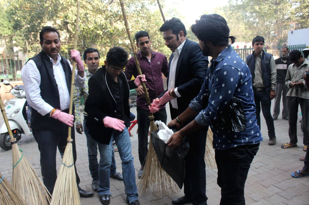 Actor Kamaal R Khan and singer Shankar Sahney participates in Clean India Campaign in New Delhi, on Nov 30, 2014.