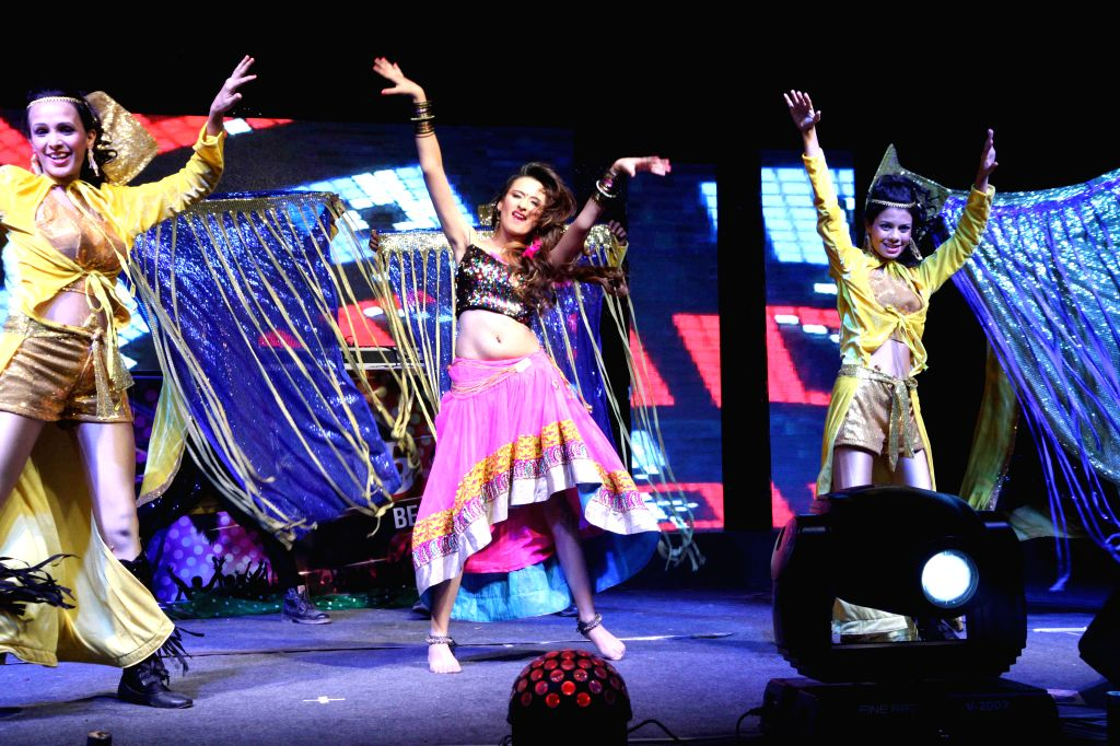 Actor Mahi Sharma performs during the new year celebrations in Mumbai, on Dec. 31, 2014. - Mahi Sharma