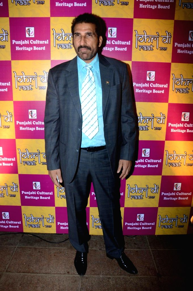 Actor Mukesh Rishi during the  Charan Singh Sapra's 'Lohri Di Raat' in Mumbai on Jan 10, 2015. - Mukesh Rishi and Charan Singh Sapr