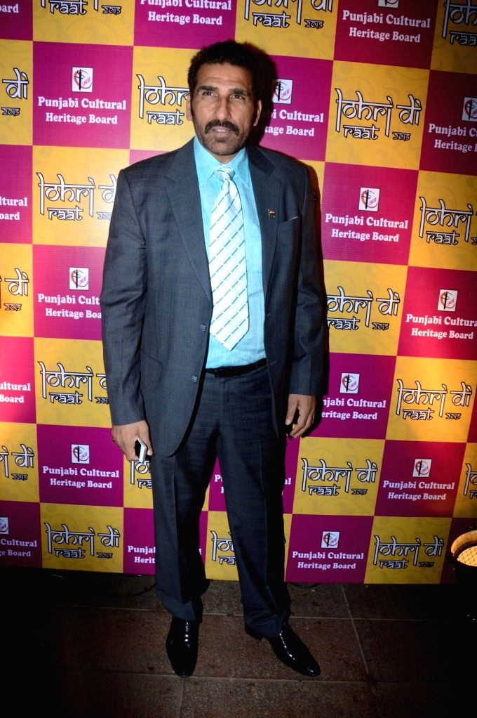 Actor Mukesh Rishi during the  Charan Singh Sapra's 'Lohri Di Raat' in Mumbai on Jan 10, 2015. - Mukesh Rishi and Charan Singh Sapr