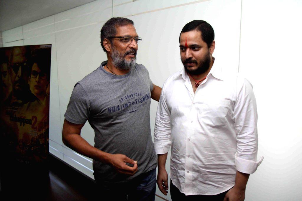 Actor Nana Patekar along with his son Malhar Patekar during the promotion of film Ab Tak Chhappan 2 in Mumbai on Feb 17, 2015. ( Photo : IANS ) - Nana Patekar