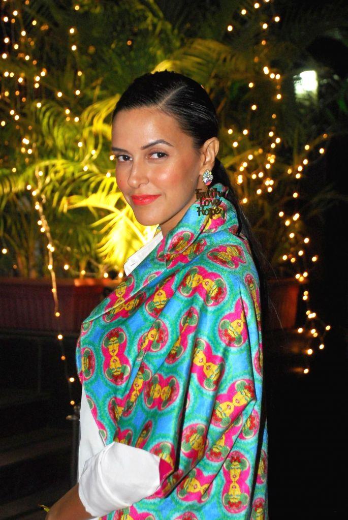 Actor Neha Dhupia during opening of Vikram Phadnis fashion store Krasaa in Mumbai on Sunday, Dec. 7, 2014. - Neha Dhupia