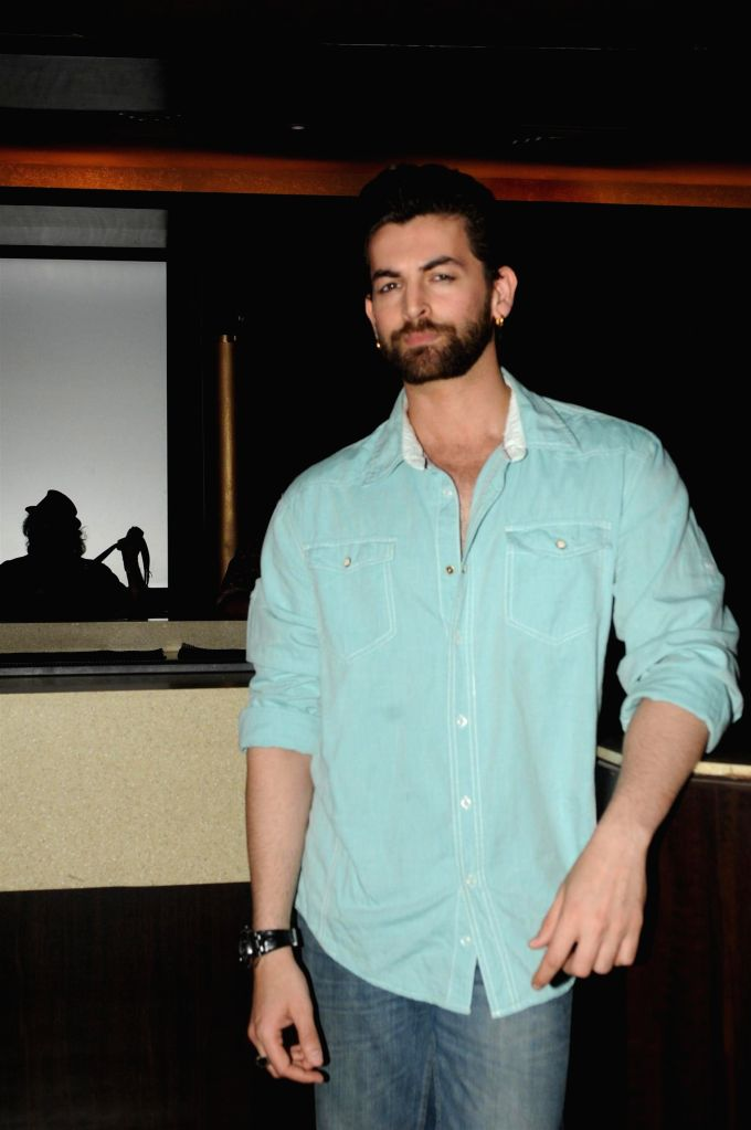 Actor Neil Nitin Mukesh walks on the ramp at the announcement of India Luxury Style Week 2015 in Mumbai on, April 28, 2015. - Neil Nitin Mukesh