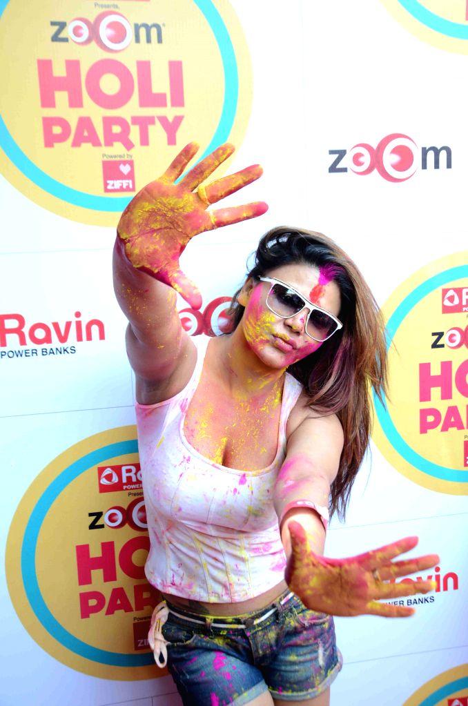 Actor Rakhi Sawant during the Zoom Holi celebrations, on March 6, 2015. - Rakhi Sawant