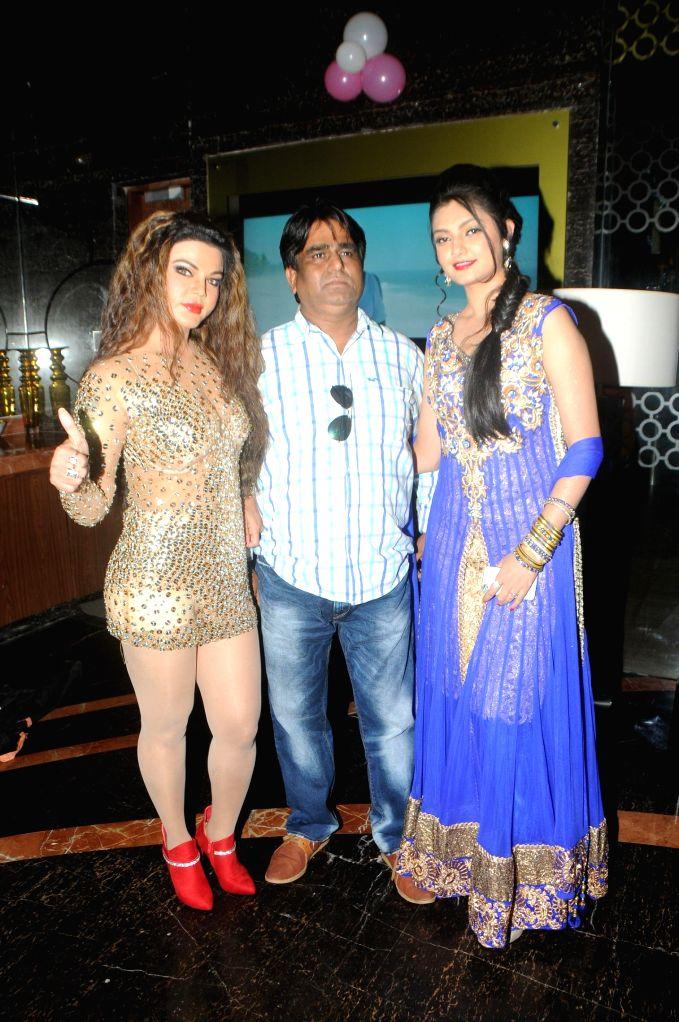 Actor Rakhi Sawant with SAchindra Sharma and Ashima Sharma during the trailer launch of film Mumbai Can Dance Saala in Mumbai, on Dec. 22, 2014. - Rakhi Sawant and Ashima Sharma