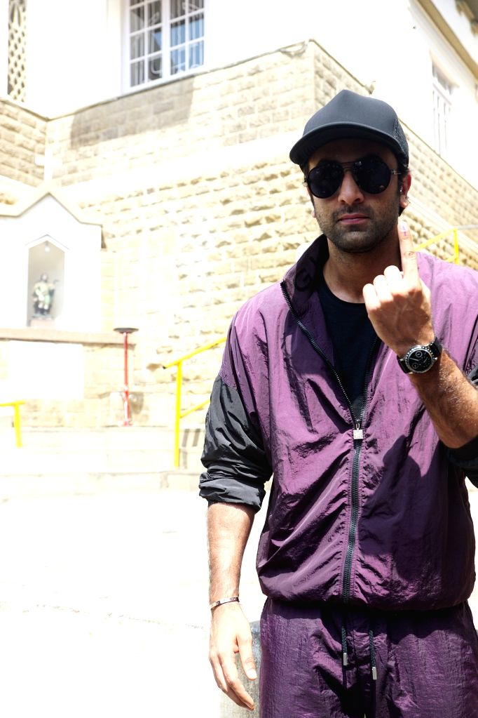 Mumbai: Actor Ranbir Kapoor shows his forefinger marked with indelible ink after casting his vote for the fourth phase of 2019 Lok Sabha elections, in Mumbai on April 29, 2019. (Photo: IANS) - Ranbir Kapoor