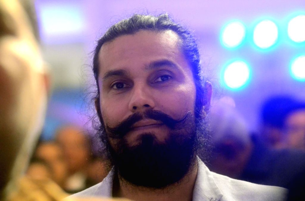 Mumbai: Actor Randeep Hooda during a roadshow organised by Confederation of Indian Industry (CII) ahead of Uttar Pradesh Investors Summit 2018, in Mumbai on Dec 22, 2017. (Photo: IANS) - Randeep Hooda