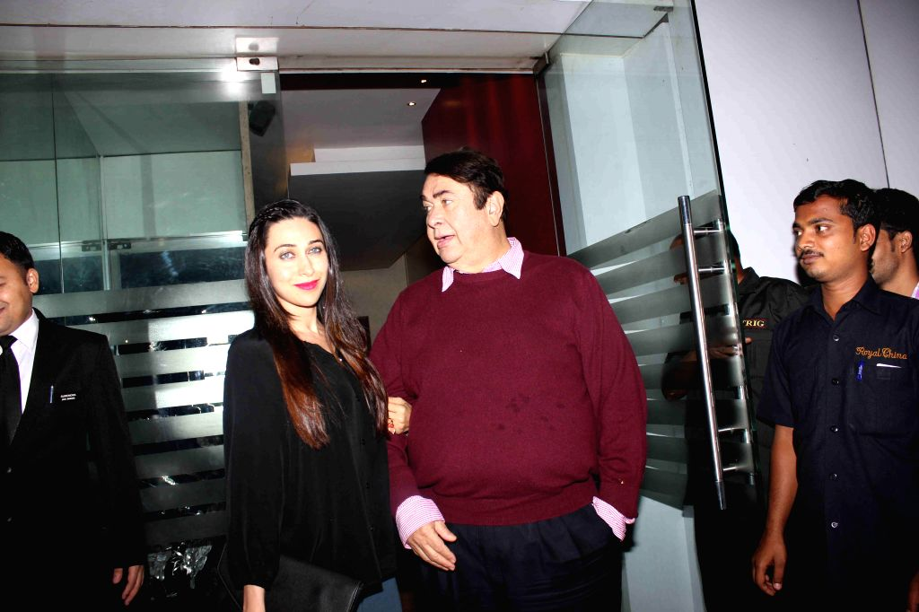 Actor Randhir Kapoor with his daughter Karishma Kapoor during the birthday party of actor Randhir Kapoor in Mumbai on Feb 15, 2015. - Karishma Kapoor