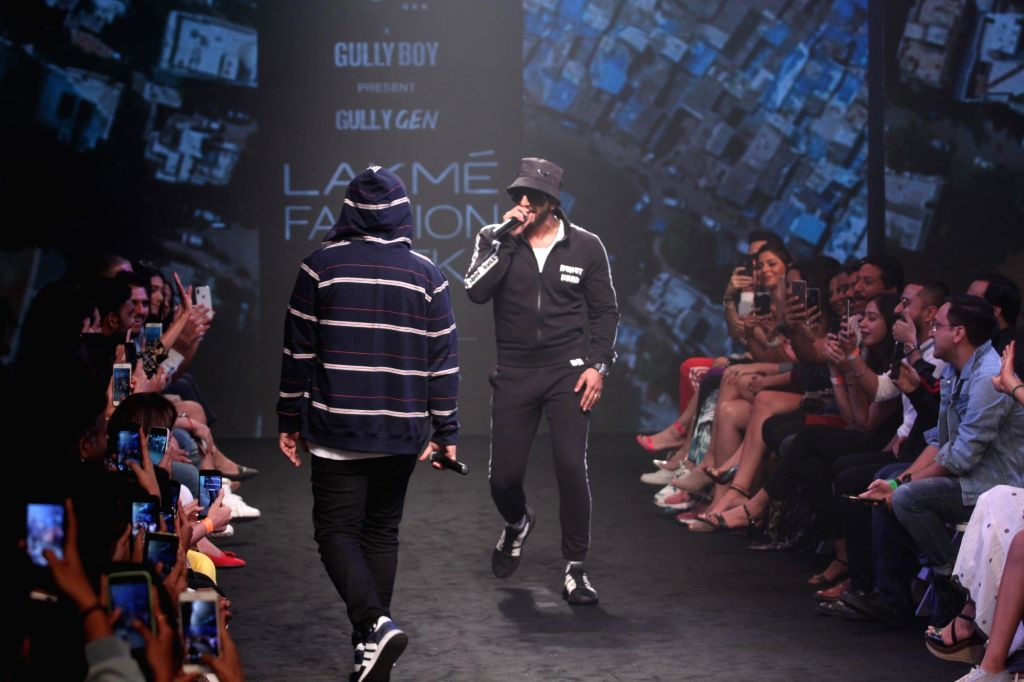 Mumbai: Actor Ranveer Singh and rapper Naezy perform during Gully Gen's show at Lakme Fashion Week (LFW) Summer/Resort 2019 in Mumbai, on Feb 3, 2019. (Photo: IANS) - Ranveer Singh