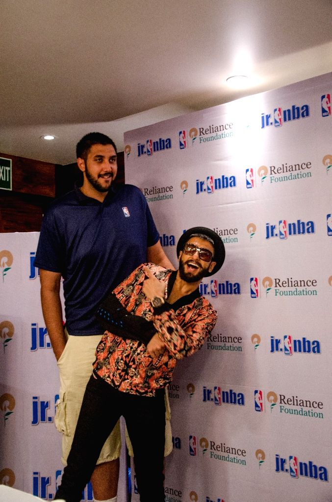 Actor Ranveer Singh meets Gursimran 'Sim' Bhullar of the Sacramento Kings in Mumbai on May 2, 2015.