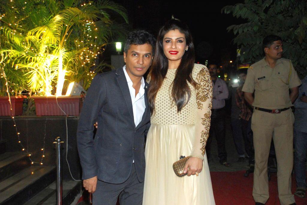 Actor Raveena Tondon and Fashion designer Vikram Phadnis during opening of Vikram Phadnis fashion store Krasaa in Mumbai on Sunday, Dec. 7, 2014. - Raveena Tondon