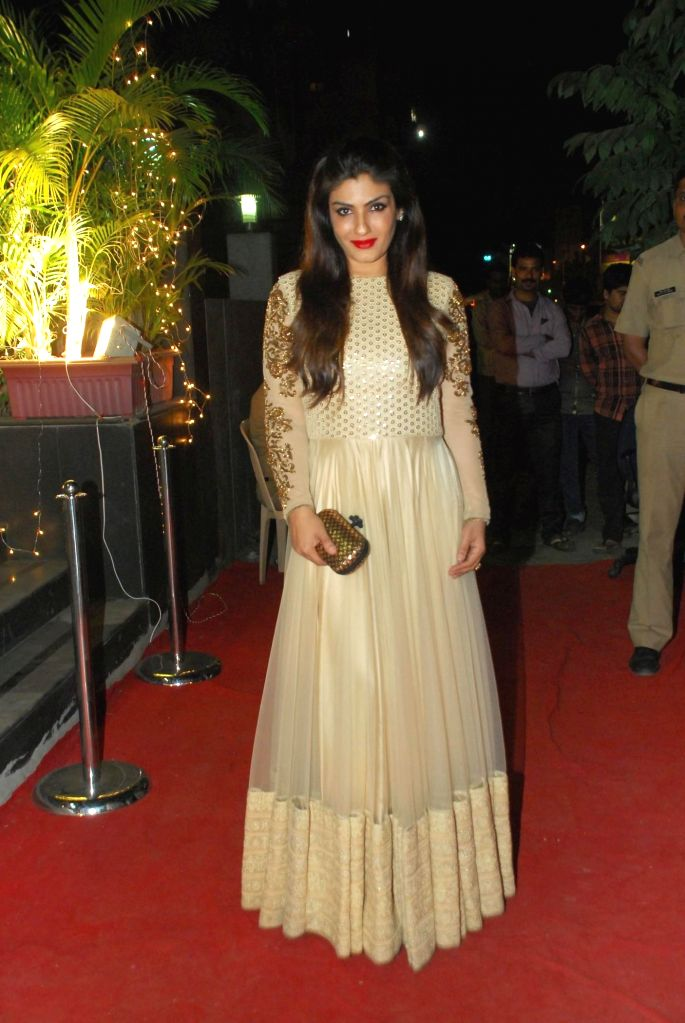Actor Raveena Tondon during opening of Vikram Phadnis fashion store Krasaa in Mumbai on Sunday, Dec. 7, 2014. - Raveena Tondon