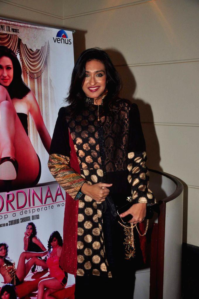 Actor Rituparna Sengupta during the music launch of film Extraordinaari in Mumbai on Dec 30, 2014. - Rituparna Sengupta