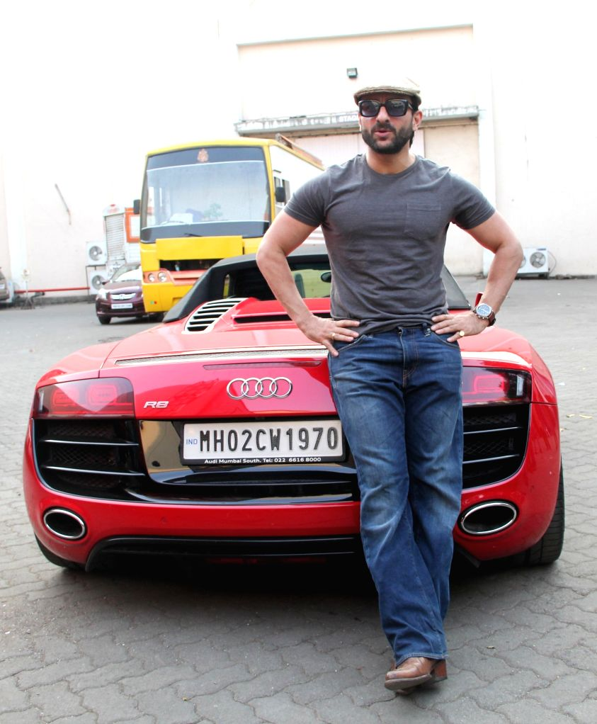 Actor Saif Ali Khan poses with his swanky Audi R8 V10 Spyder car in Mumbai , on Nov 17, 2014.