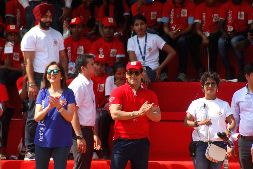 Actor Salman Khan with Nita Ambani during the launch of Young Champs by Reliance Foundation in Mumbai on Sunday, Dec. 7, 2014. - Nita Ambani