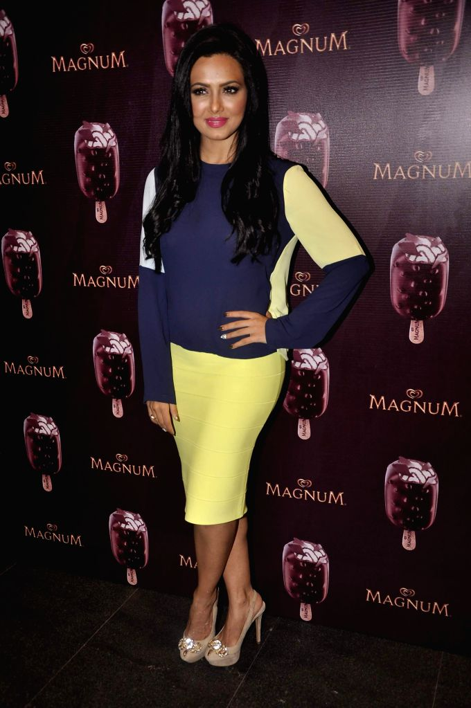 Actor Sana Khan during the launch of a new Choco Cappuccino flavour of HUL`s Magnum Icecream in Mumbai on Feb 22, 2015. - Sana Khan
