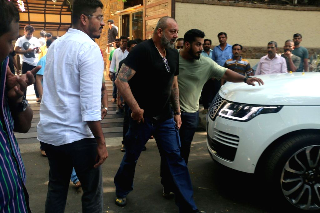 Mumbai: Actor Sanjay Dutt arrives to pay tributes to Bollywood's veteran action director Veeru Devgan, who passed away, at the Devgan residence in Mumbai on May 27, 2019. (Photo: IANS) - Sanjay Dutt